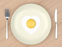 Heart fried egg in grey  plate Stock Image