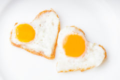 Heart fried eggs Royalty Free Stock Image