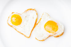 Heart fried eggs Stock Images