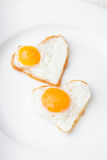 Heart fried eggs Stock Photo