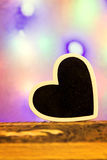 A heart in front of a colorful background Royalty Free Stock Photo