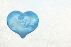 Heart on a frozen window Stock Photos