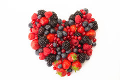 Heart of fruit. Mixed fruit in shape of a heart on a white background Stock Photography