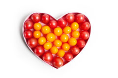 Heart with fruit production. Arranged in a heart-shaped pattern with tomatoes Stock Image