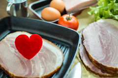 Heart in a frying pan for Love or Heart Healthy Cooking Concept Stock Image