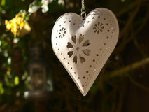 Heart in Garden. Heart shaped candle holder in garden Royalty Free Stock Photos