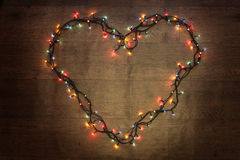 Heart of garland. Glowing garland lights dark background wire Royalty Free Stock Photography