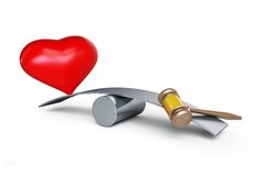 Heart and gavel balances. On a white background Royalty Free Stock Photo