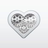 Heart from a gear wheel on a grey background. Royalty Free Stock Photography
