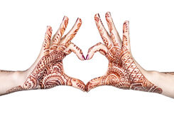 Heart gesture with henna. Woman hands with henna doing heart gesture isolated on white background with clipping path stock photography