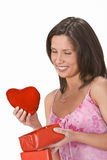 Heart gift. Woman taking out a plush heart from a gift box Royalty Free Stock Image