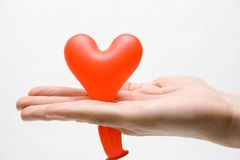 Heart in gift. Hand keeps air ball Stock Photo
