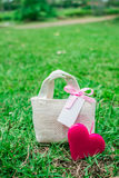 Heart and a gift bag Stock Photos