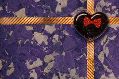 Heart gift box. Heart gift box on the background paper Royalty Free Stock Photos