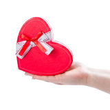 Heart gift box. On female hand, isolated on white background Royalty Free Stock Image