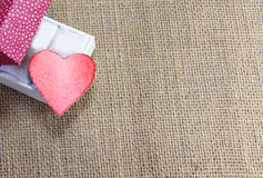 Heart in gift box. On jute cloth background Stock Image