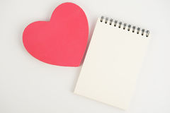 Heart gift box and note book  on white background Royalty Free Stock Image