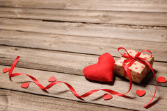 Heart and gift box with red ribbon Royalty Free Stock Photography