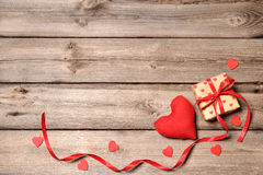 Heart and gift box with red ribbon Stock Image