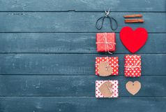 Heart and gift boxes over wooden background. Flat lay stock image