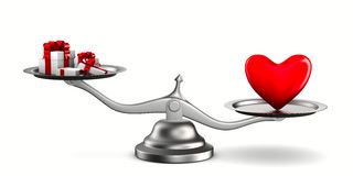Heart and gift boxes on scales Royalty Free Stock Photo