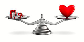 Heart and gift boxes on scales Stock Photo