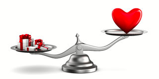 Heart and gift boxes on scales Stock Photos