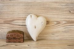Heart and gift. In front of a wood background Stock Photos
