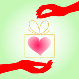 The heart of a gift from hand to hand Stock Photo