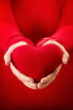 Heart gift. Hands holding a red heart gift Royalty Free Stock Photo