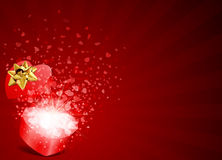 Heart gift present with fly hearts. Valentine's day background Stock Image