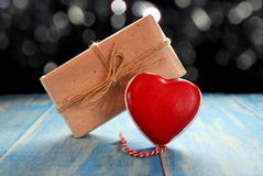 Heart and gift Stock Images