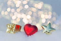 Heart, gift and star on snow. stock photography