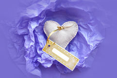 Heart with a gift tag Royalty Free Stock Image
