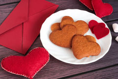 Heart gingerbread cookies and red envelope Stock Image