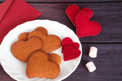 Heart gingerbread cookies and red envelope Royalty Free Stock Photo
