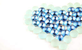 Heart glass marbles Royalty Free Stock Image