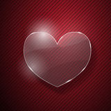 Heart from glass. On red striped background Royalty Free Stock Image