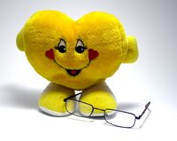Heart and glasses. Glasses on very nice yellow heart stock photo
