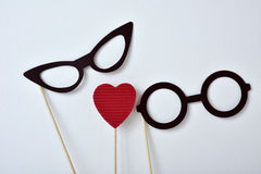 Heart and glasses for men and for women Royalty Free Stock Photo
