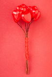 Heart glossy bunch on red background Royalty Free Stock Photo