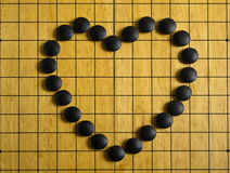 Heart on Go board Stock Photo