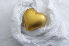 Heart Of Gold. Golden Lonely Heart on crushed paper nest Stock Image