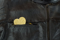 Heart of gold on black leather jacket Stock Image