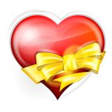Heart with gold bow Royalty Free Stock Images