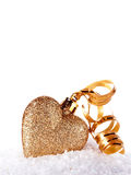 Heart with gold tape on snow. Christmas-tree decorations in the form of heart. Valentine's Day. February 14. Winter holiday stock photos