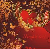 Heart with gold wings. Pair of hearts with wings in an environment of a vegetative ornament and butterflies Stock Photo