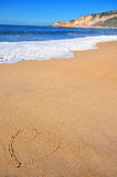 The heart on the golden beach sand Stock Images