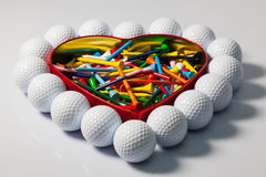 Heart of golf balls and tees stock images