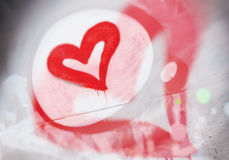 Heart graffiti closeup. Grungy style love concept. Stylization of design with on the wall in the city, Valentine`s Royalty Free Stock Images
